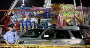 Authorities stand near the Fire Ball amusement ride after the ride malfunctioned on Wednesday. Photograph: Barbara J Perenic/The Columbus Dispatch via AP