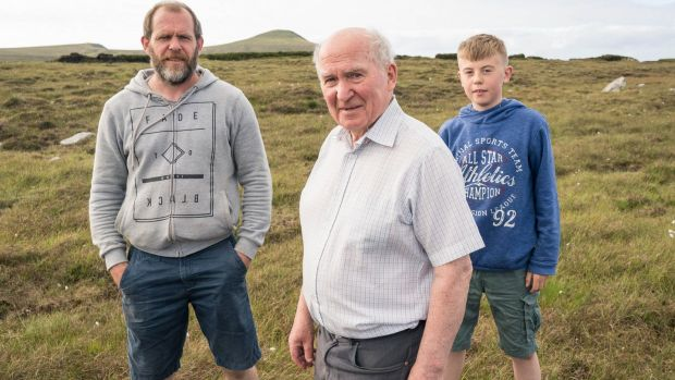 Archaeologist Seamus Caulfield with his son Declan and grandson Fionnán (12) at Belderrig, Co Mayo. Photograph: Keith Heneghan/Phocus