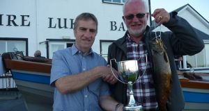 Bilberry chairman, Mick Butler (left) presenting the McConville Cup to Matt Whitelaw following his win on Mask.