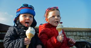Hugh and Emma Sweeney from Firhouse, Co Dublin, enjoying ice-cream cones  on the East Pier at Dun Laoghaire. Photograph: Eric Luke / The Irish Times