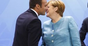 Mrs Merkel has put the financial transaction tax into her government programme and President Macron has raised French concerns over what the OECD calls profit shifting. Photograph: Michele Tantussi/Getty Images