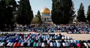 Palestinian Muslims bow in prayer inside the Haram al-Sharif compound, known to Jews as the Temple Mount, in the old city of Jerusalem, with the Dome of the Rock in the background. File photograph: Ahmad Gharabli/AFP/Getty Images