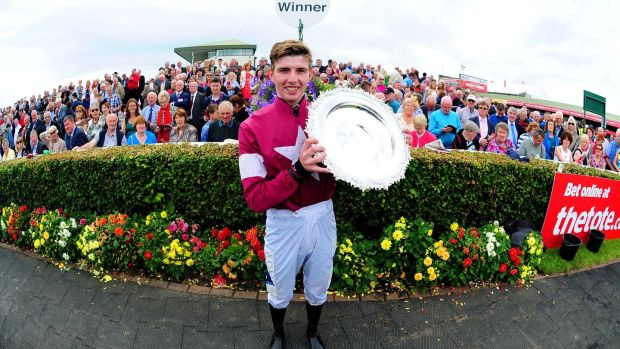 Winning jockey Donagh Meyler with the trophy. Photograph: Healy Racing
