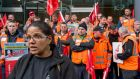 Unite regional organiser  Tayra McKee with crane drivers as they protested outside the Health and Safety Authority headquarters in Dublin on Thursday. Photograph: Brenda Fitzsimons