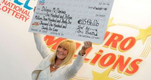Dolores McNamara with her cheque for  over €115 million. Photograph: Mac Innes Photography