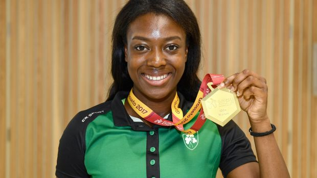 Gina Akpe-Moses shows off her gold medal from the 100m at the European Athletics Under-20 Championships in Italy on the Ireland squad's return at Dublin Airport. Photograph: Sam Barnes/Sportsfile