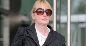 Eve Doherty (49), a Dublin based garda, leaves the Dublin Circuit Criminal Court on Friday where she has  pleaded not guilty to the harassment of Elizabeth Howlin, who worked in the office of the Director of Public Prosecutions. Photograph:  Collins Courts.