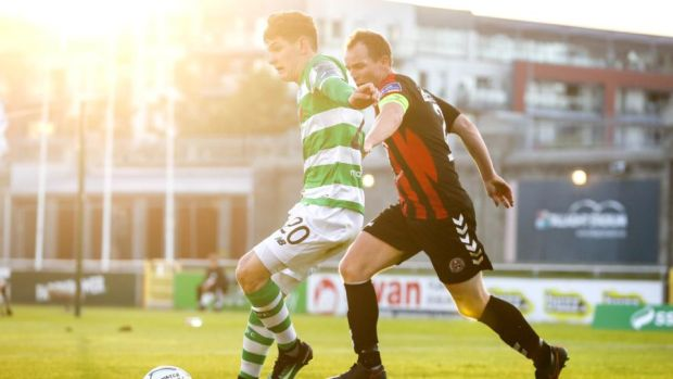 Trevor Clarke and Derek Pender tussle for the ball at Tallaght Stadium. Photograph: Inpho