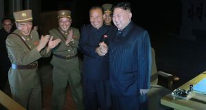Kim Jong-Un (R) celebrating a test launch of an intercontinental ballistic missile, Hwasong-14 at undisclosed place in North Korea. Photograph: KCNA news agency/Getty IMages