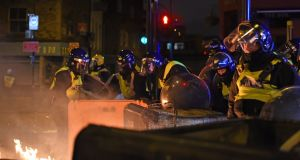 Riot police at a protest in Kingsland Road in east London, where people gathered in response to the death of Rashan Charles. Photograph: Lauren Hurley/PA Wire
