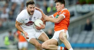 Kildare's Fergal Conway is challenged by  Armagh's Niall Grimley during the All-Ireland Round 4B qualifier at Croke Park. Photograph: Oisín Keniry/Inpho