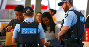 Australian police speak with passengers at the Sydney Airport domestic terminal. Photograph: REUTERS/David Gray