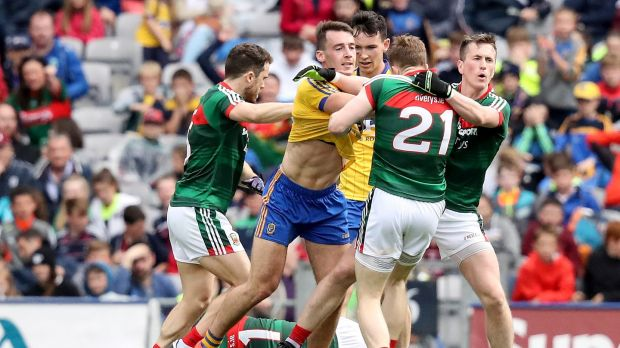 Roscommon's John McManus confronts Mayo's Donal Vaughan. Photo: Oisin Keniry/Inpho