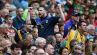 Roscommon fans cheer on their team during their All-Ireland SFC semi-final draw with Mayo. Photo: Inpho
