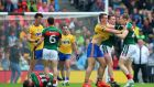 Roscommon's John McManus argues with Cillian O'Connor and Donal Vaughan of Mayo. Photo: James Crombie/Inpho