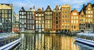 Traditional houses in Amsterdam, Netherlands. MUFG would be the first global lender to pick the Dutch city as its new EU hub