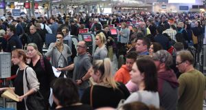 Passengers at  Australian airports, experienced longer-than-usual queues Monday morning. Photograph: Dean Lewis/Retuers