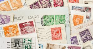 Stamps are another thing I miss about postcards. Photograph: Getty