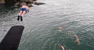 Taking a dive at  Guillamene, Tramore, Co Waterford. Photograph: Patrick Browne Jnr