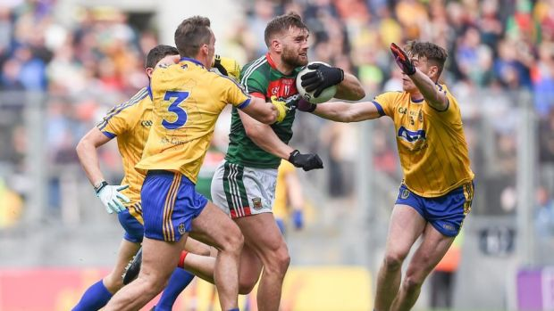 Mayo's Aidan O'Shea is challenged by three Roscommon players during the drawn All-Ireland quarter-final. Photograph: Tommy Grealy/Inpho