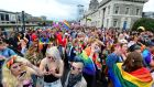 Participants of the gay pride parade in Dublin last year. Gardaí will join their Northern Irish counterparts in Belfast on Saturday and take part in the city's Pride event. Photograph:  Dara Mac Donaill