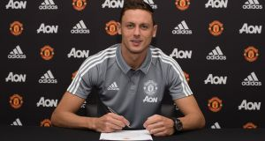 Nemanja Matic signs for Manchester United at Aon Training Complex in Manchester. Photograph: Man Utd via Getty Images