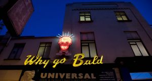 The iconic  neon sign  on the side of the Universal Hair and Scalp clinic in South Great George's Street, Dublin