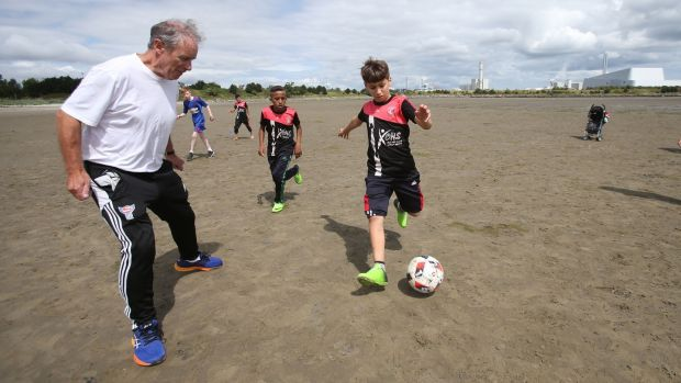 Brian Kerr with members of the Al-Helal football academy during a training session on Dublin's Sandymount Strand. Photograph: Niall Carson/PA