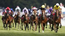 Andrea Atzeni riding Stradivarius (black/yellow cap) to win The Qatar Goodwood Cup  from Big Orange. Photograph:  Alan Crowhurst/Getty Images