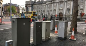 Metal boxes located on College Green, Dublin, for the new Luas lines. Photograph: Bryan O'Brien