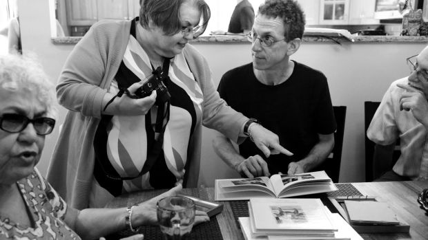 Phylis Pullman, first cousin to Alice Collins Plebuch, and Alice (centre) chat with Alice's second cousins Dan Klein and Jerry Klein, in Seaford, New York. Photograph: Yana Paskova for The Washington Post/Getty Images