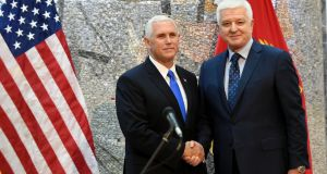 US vice-president Mike Pence and Montenegrian prime minister Dusko Markovic shake hands during a joint press conference following their meeting in Podgorica, Montenegro, on Wednesday. Photograph: Boris Pejovic/EPA