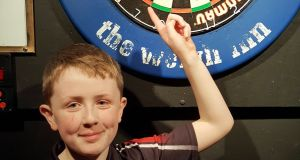 Darts player Alex Hughes has qualified for the Worthington's Champion of Champions finals in Wales at the age of 11. Photo: Joe Boland/NorthWestNewsPix