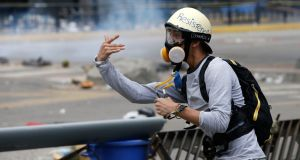 A demonstrator uses a slingshot during clashes that marked the constituent assembly election in Caracas, Venezuela on Sunday. Photograph:  Andres Martinez Casares/Reuters