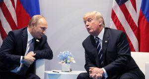 Russian president Vladimir Putin  and US president Donald J Trump  meet on the sidelines of the G20 summit in Hamburg last month. Photograph:  EPA