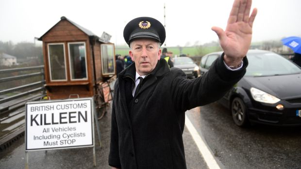 John McNamee, dressed as customs workers, joined other members of Border Communities Against Brexit earlier this year to protest against Brexit by setting up an old customs post at Carrickcarnon between Dundalk and Newry. Photograph: Dara Mac Dónaill / The Irish Times