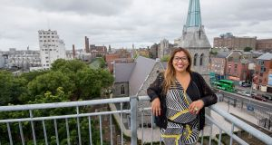 Patricia Guerra from Peru who moved to Ireland 8 years ago, photographed on the rooftop of her apartment. Photograph: Brenda Fitzsimons
