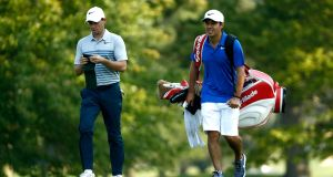 Rory McIlroy of Northern Ireland speaks to his new caddie Harry Diamond during a practice round before the World Golf Championships - Bridgestone Invitational at Firestone Country Club South Course in Akron, Ohio. Photo: Sam Greenwood/Getty Images