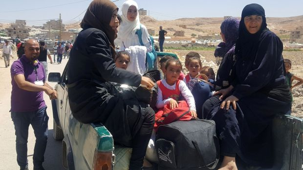 Syrian refugees arrive in Wadi Hamayyed, on the outskirts of Lebanon's northeastern border town of Arsal, to board buses bound for the northwestern Syrian town of Idlib on Wednesday, August 2nd. Photograph: Stringer/AFP/Getty