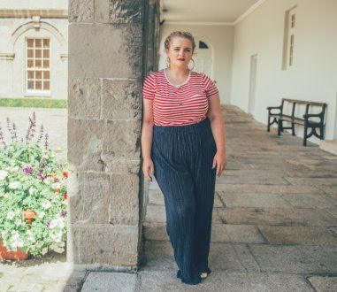 fb9ad4ef43be5 Louise McSharry wears a red striped T-shirt  H M  trousers  Asos Curve   shoes  H M  necklace  Alex   Ani  earrings  H M. Photograph  Ruth Medjber  ...