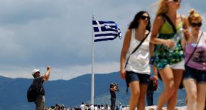 Tourists visit the archaeological site of the Acropolis hill in Athens, Greece.     Photograph: Yiorgos Karahalis/Reuters