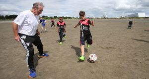 Former Republic of Ireland Football Manager Brian Kerr takes part in a training session with players from Al-Helal Football Academy in Gaza, on Sandymount Strand in Dublin  earlier this week. Photograph: Niall Carson/PA Wire