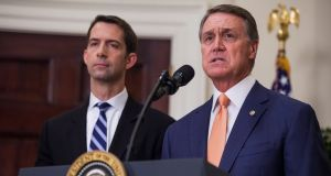 The sponsors of the new Bill, which would reduce legal immigration to the US, Republican senators Tom Cotton of Arkansas and David Perdue of Georgia. Photograph: Zach Gibson/EPA