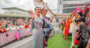 Aoife McCana, left,  winner of the Best Dressed Lady at the Galway Races and Oniesa Owens,  Cavan, who won for Best Hat. Photograph: Brenda Fitzsimons