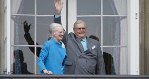 Denmark's Queen Margrethe II and Prince Henrik wave from a balcony at Amalienborg Palace in Copenhagen. File photograph: Marie Hald/Scanpix/Reuters