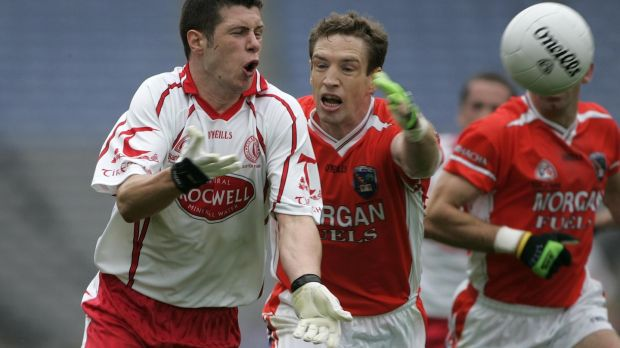 A young Sean Cavanagh in action against Armagh's Kieran McGeeney during the Ulster final replay of 2005. Photographer: Dara Mac Dónaill
