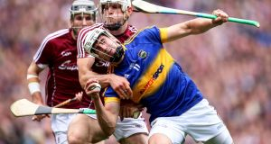Gearóid McInerney attempts to bottle up  Patrick Maher in last year's semi-final. Photograph: Inpho/Tommy Dickson