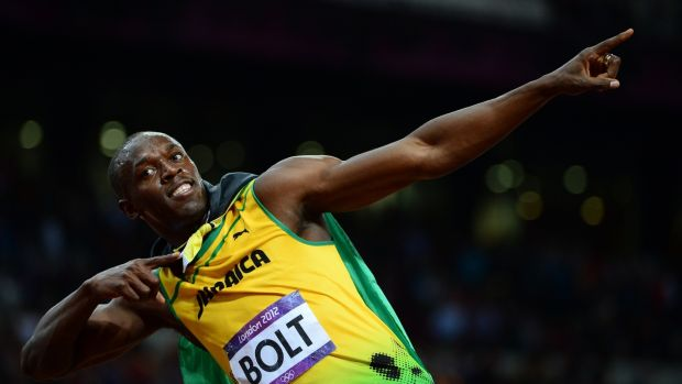 Usain Bolt celebrating after winning the men's 100m final at the athletics event during the London 2012 Olympic Games in London. Photograph: Olivier Morin/AFP/Getty Images