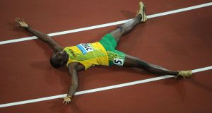 Usain Bolt celebrating winning the men's 200m final at the National stadium as part of the 2008 Beijing Olympic Games. Photograph: Christophe Simon/AFP/Getty Images