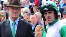 Trainer Willie Mullins and  Ruby Walsh after winning with  Minella Beau during day three of the Galway  festival.  Photograph: PA Wire